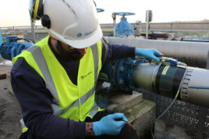 A man working on a wastewater treatment plant